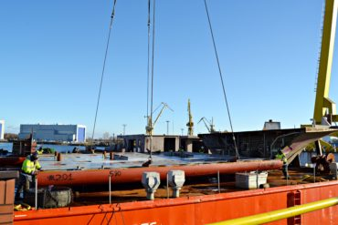 Preparations for transporting the passenger ship's hull sections.